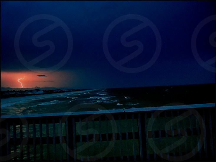 Lightning storm seen from the St Andrew State Park Pier Panama City Beach Florida. photo