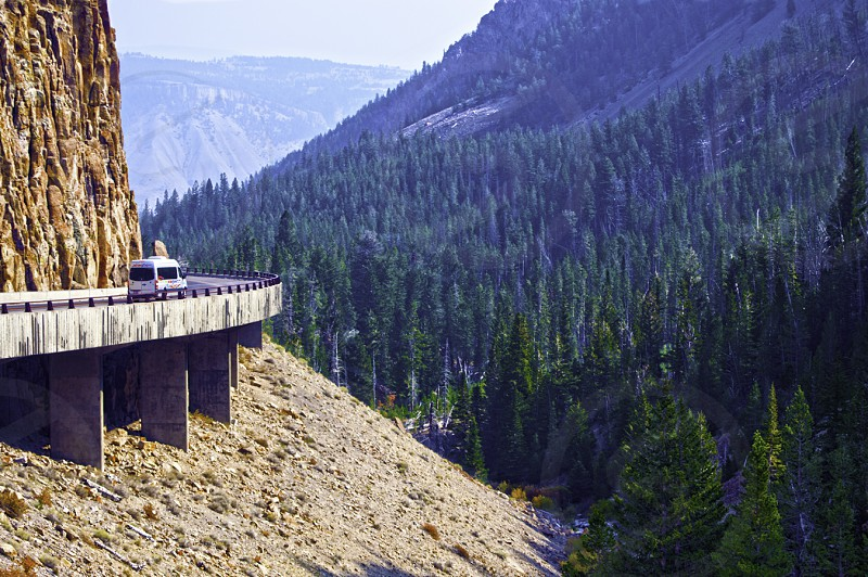 Winding mountain road in Yellowstone WY photo