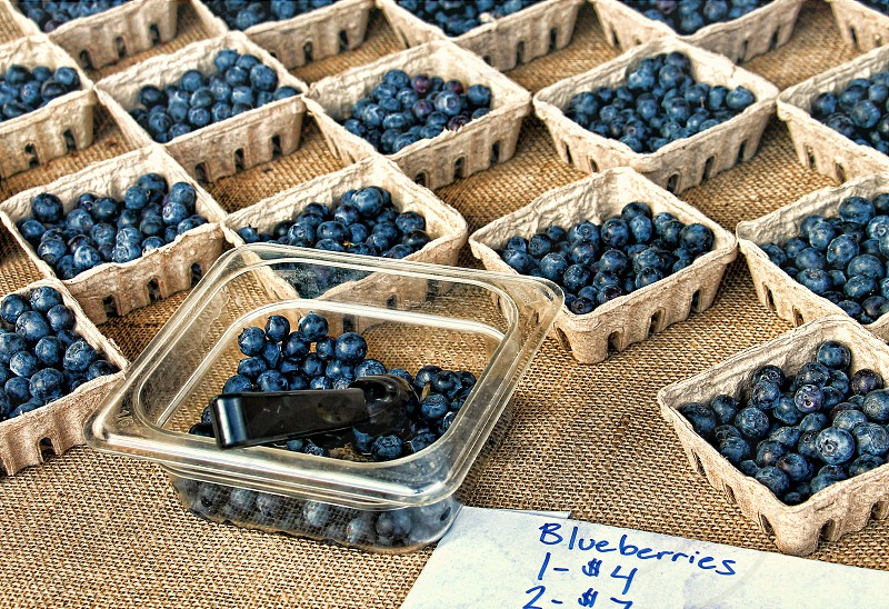 Containers of fresh blueberries for sale at a farmer's market photo