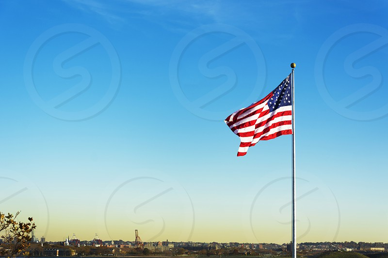 United States of America national Flag waving. Patriotic concept. Outdoor shot photo