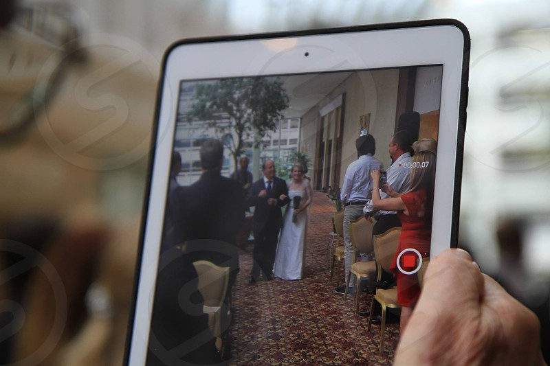 white ipad showing wedding photo