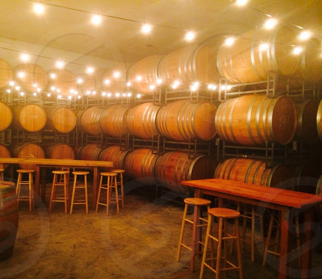 brown barrels and tables in room photo