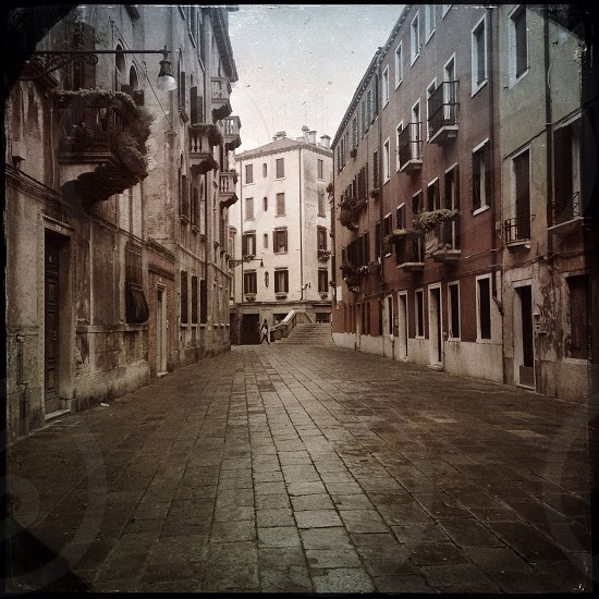 woman walking through Venice street all alone. photo