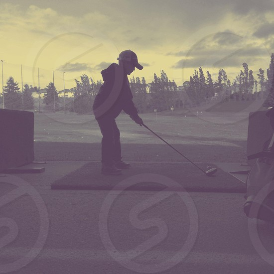 Golfer in training. He loves the game. Used B1 to play with this pretty shot. photo