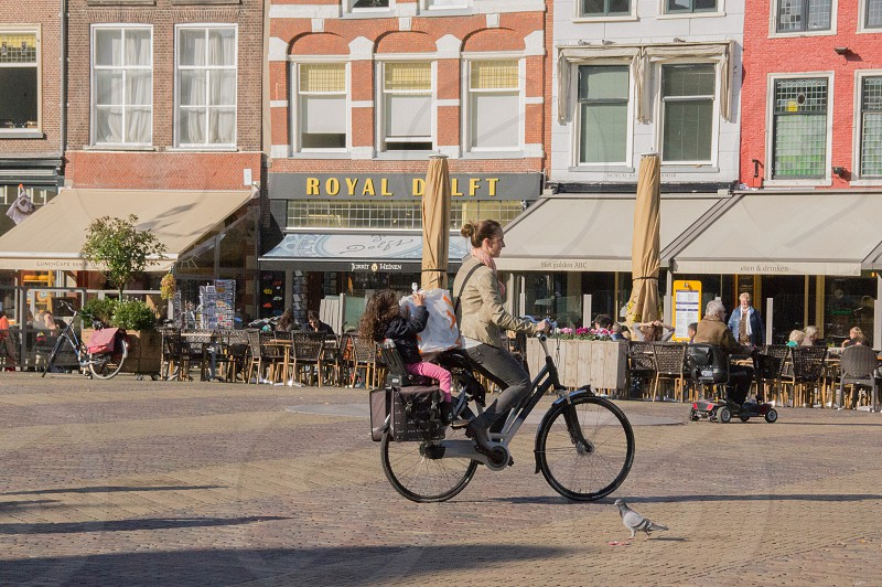 Bicycle kid parent errand town square photo