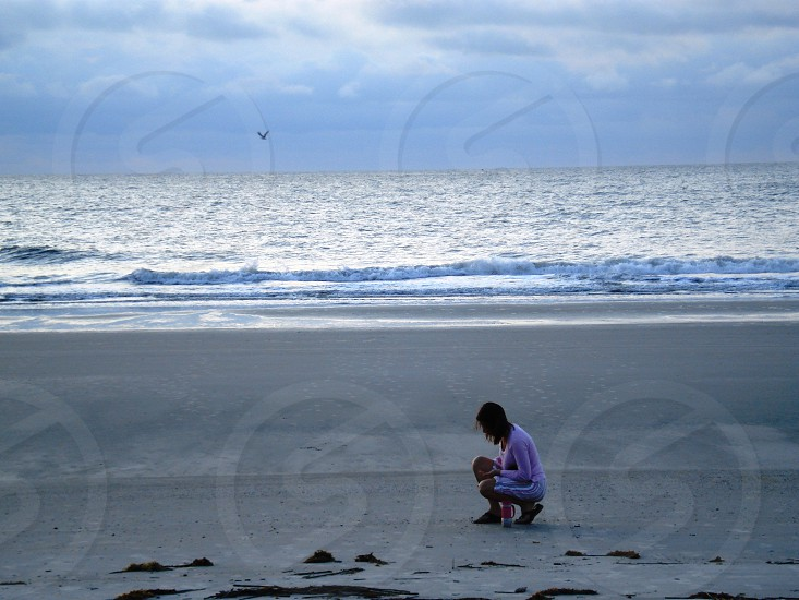 Woman looking for shells on the beach. (Original color) Hilton Head Island SC photo