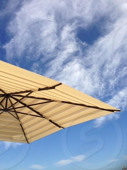 beige and black outdoor umbrella photo