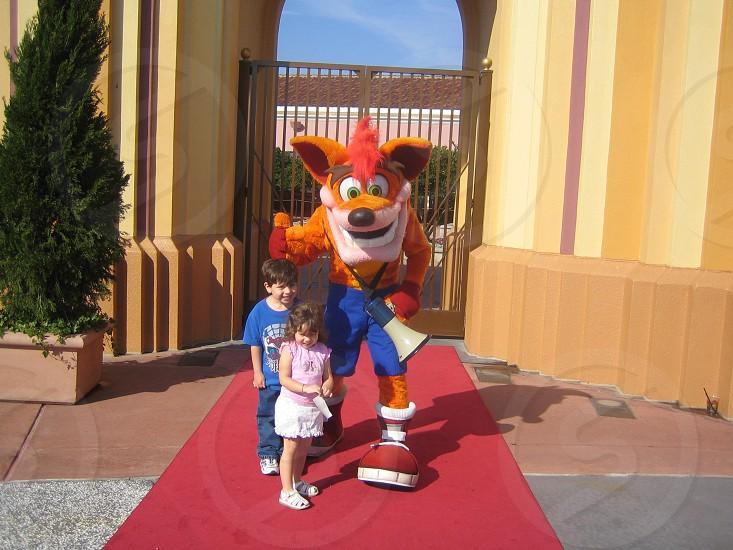 The kids with Crash Bandicoot in Universal Orlando Florida U.S.A. photo