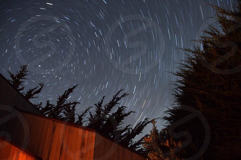 Night nighttime star stars trail trails time circle circles tree trees California Sky above heaven heavens rotate photo