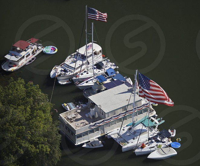 Boats gather off of Mandeville Island on the 4th of July in the California Delta the west's largest estuary that provides water for 23 million Californians. photo