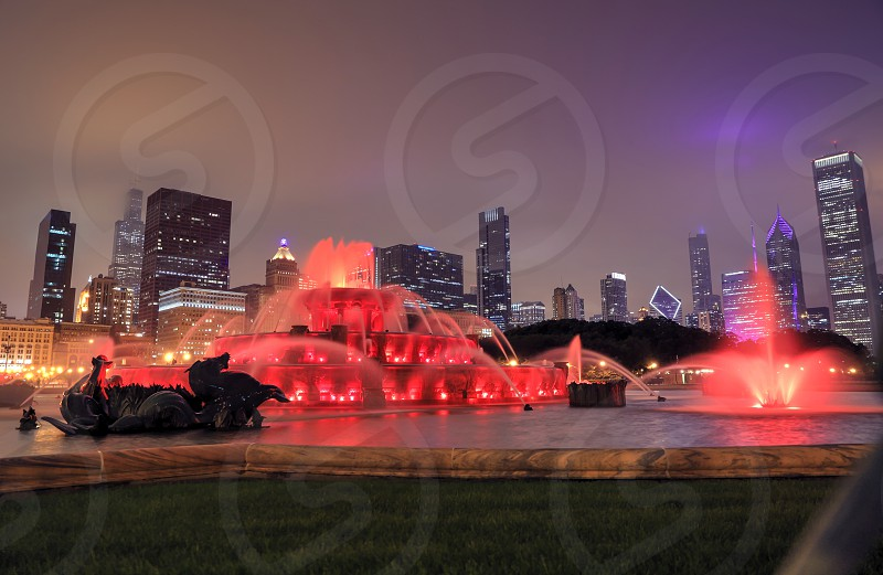 Buckingham Fountain and the Chicago Illinois skyline at night. photo