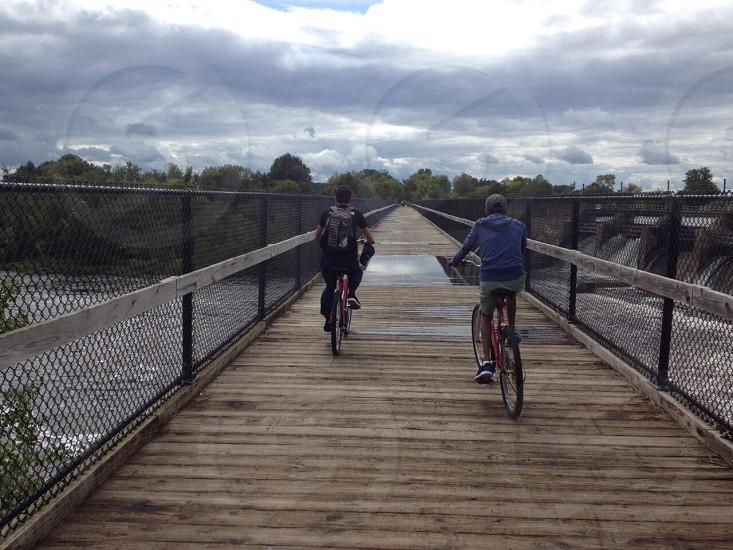 Cycling #friends #diversity #bridge #bros #back  photo