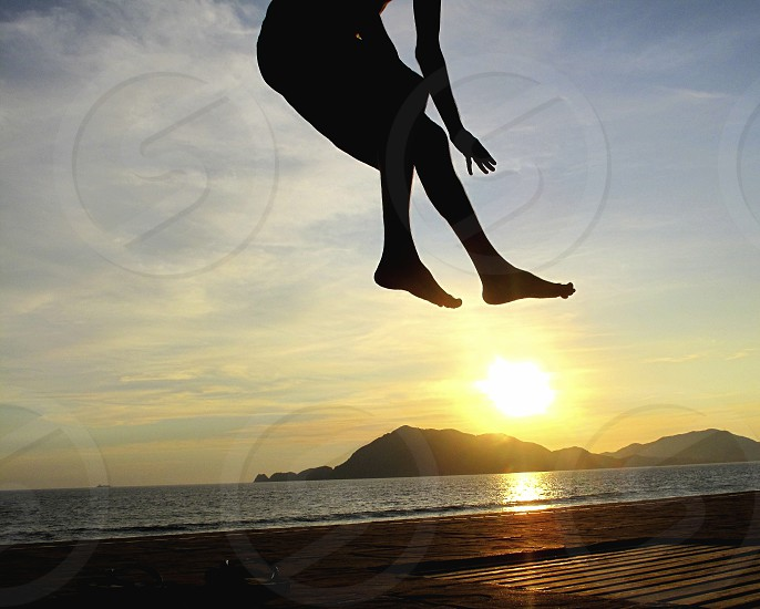man silhouette and sunrise view photo