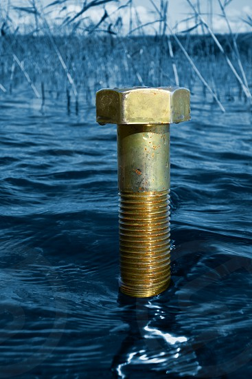 A large bolt coming out of the lake water on a sunny Autumn afternoon in Finland with ecology environmental protection and green concept idea. photo
