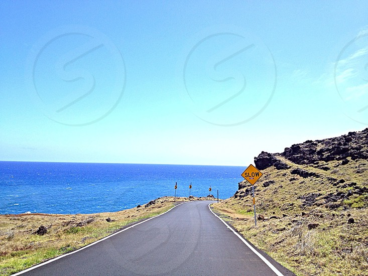 Hawaii road ocean slow sign photo