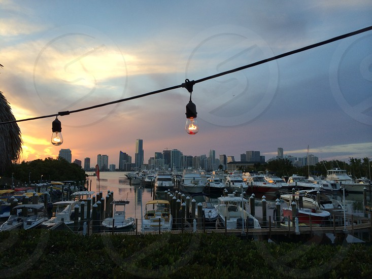 Overlooking #Miami at sunset. Great string of lights in frame and boats taking a break before they head back on the water. photo
