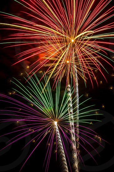 red green yellow red and purple brocade fireworks stage pyrotechnics display during nighttime photo