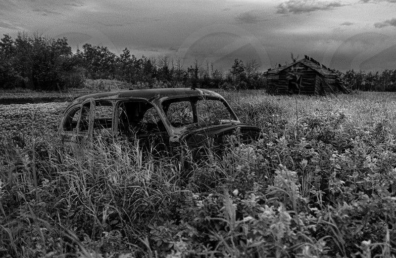 Black and White care in scene with old scenic building. photo