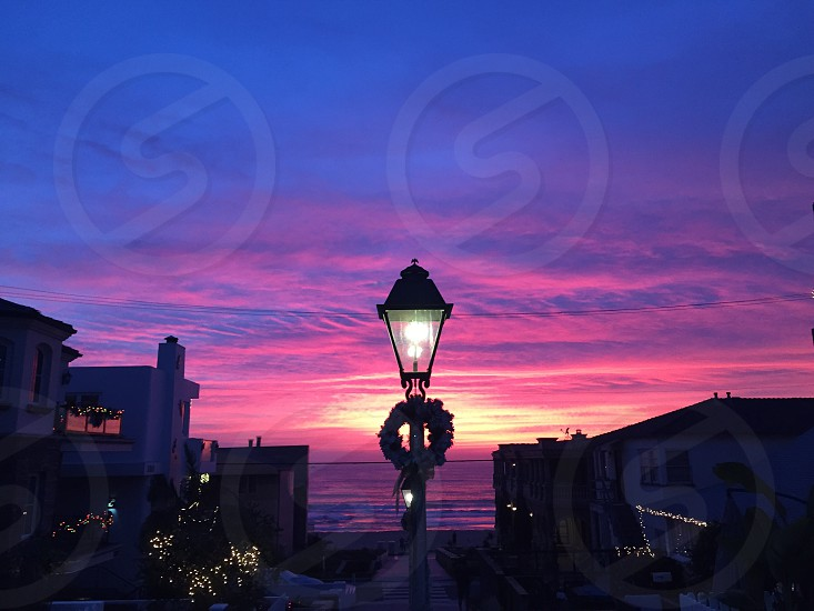 street lamp with wreath at dusk photo