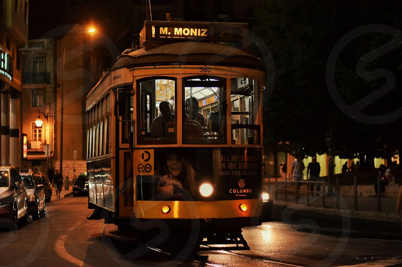people riding black and white tram during night photo