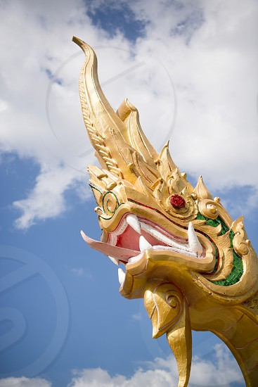 a Phayanak or Naga Statue at the mekong river in the town of Nong Khai in Isan in north east Thailand photo