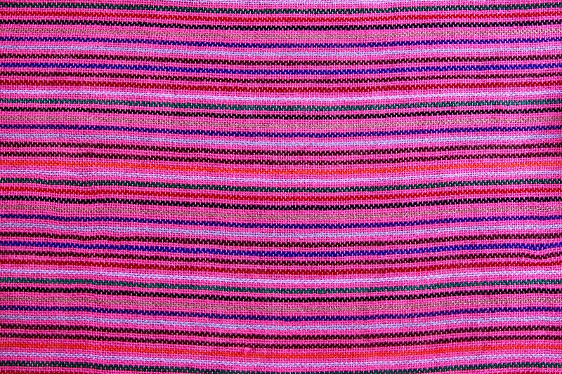 Mexican serape vibrant pink macro fabric texture background photo