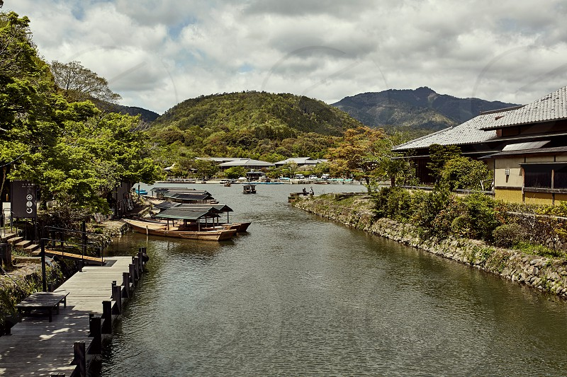 View down the canal of the Hozu River with mountains in the distance.  Arashiyama Japan photo