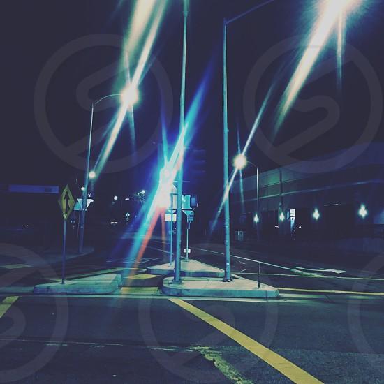 photo of lampposts between asphalt roads photo