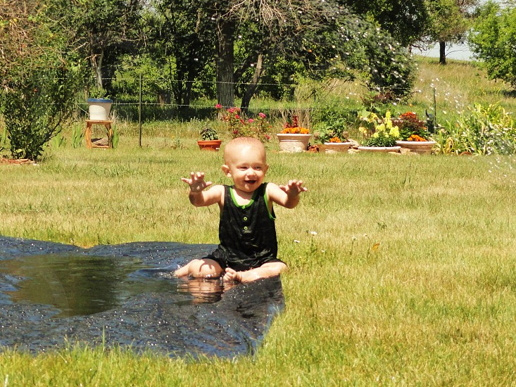 baby playin on the swamp photo