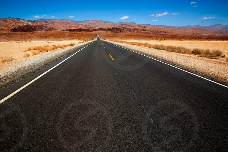 Death Valley straight road in desert National Park California California photo