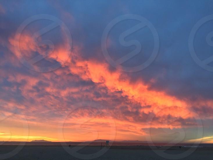 beach sand during orange sunset photo
