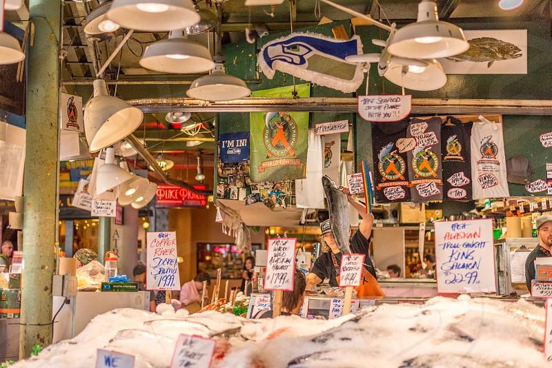 Fish market at Pike Place Market Seattle WA. photo