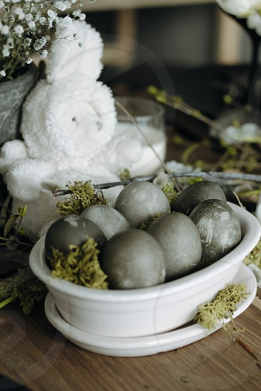 Easter Easter decorations Easter table Easter bunny eggs dyed eggs grey green spring springtime wooden table natural light photo