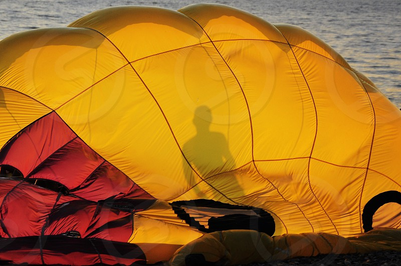 yellow and red parachute photo