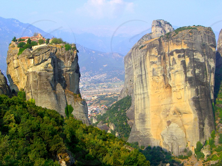 Monasteries high up on mountain rock formations in Meteora Greece photo