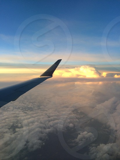 Plane wing sunset clouds above flying photo