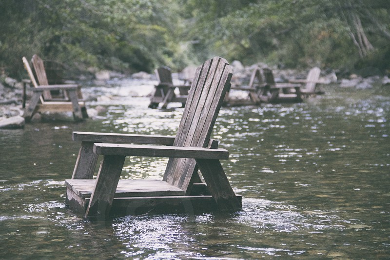 brown wooden armchair on water photo
