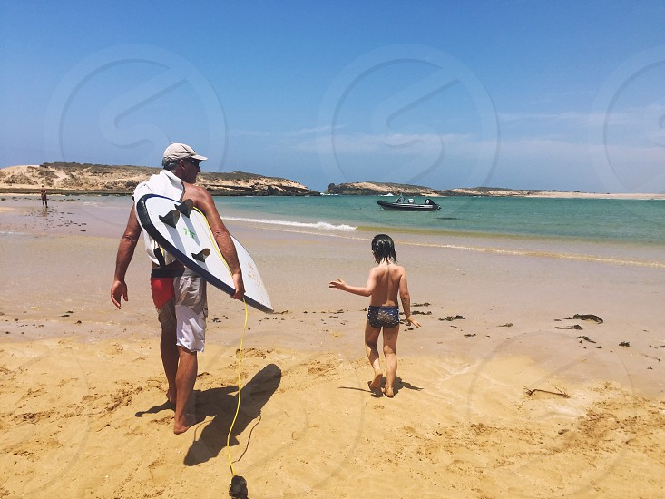 father and son going surfing photo