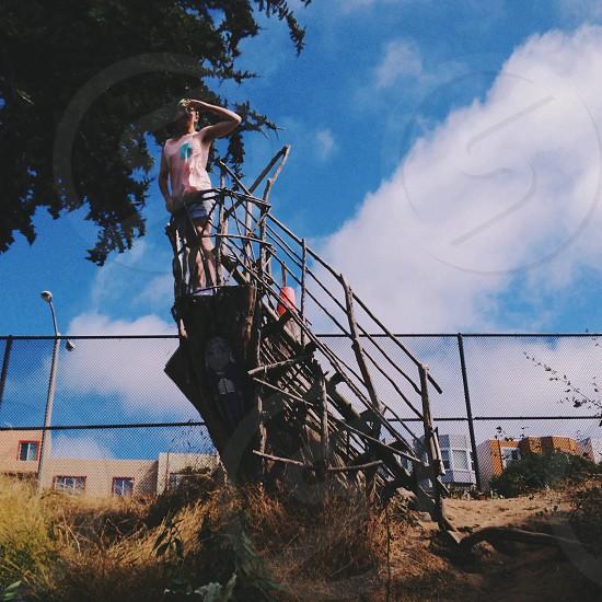 human standing on ship wreck photo