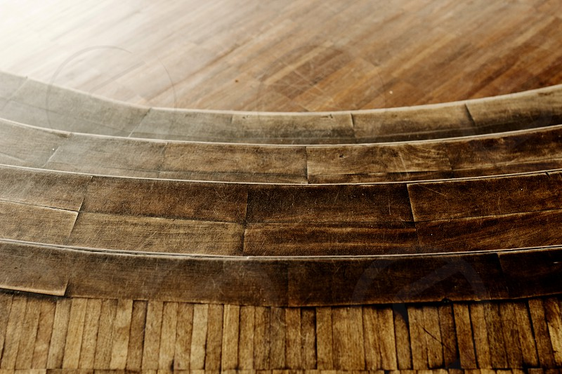 Interesting pattern created of a wooden stairs in the antique building. photo