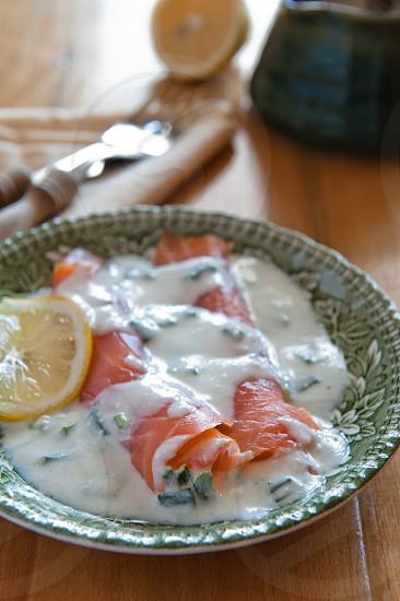 Salmon with white sauce photo