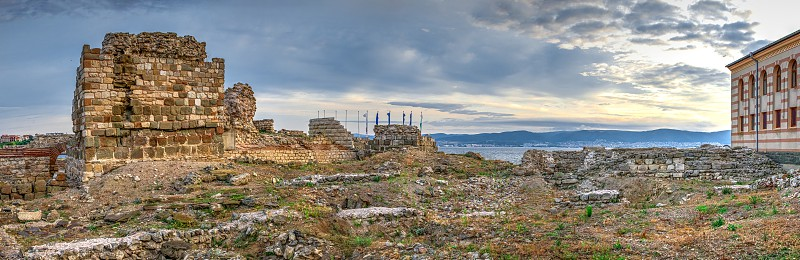 Nessebar Bulgaria – 07.10.2019.  The ruins of the fortress wall and tower of the old town of Nessebar in Bulgaria on a summer morning photo