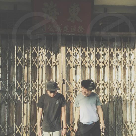 two men standing beside the scissor door photo