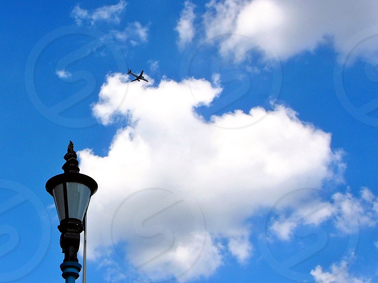 plane on air with white clouds photo