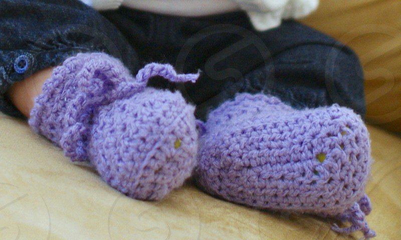 baby wearing purple crochet socks photo
