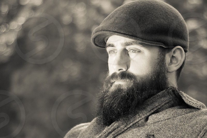 Bearded man sitting in afternoon sun photo