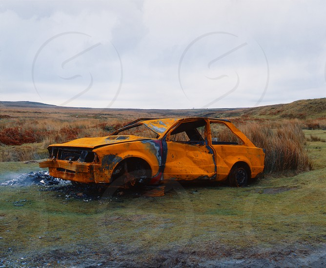 Rusty burnt out car on Dartmoor Devon UK. photo