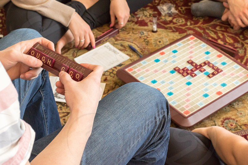 Four friends playing a board game.  No recognizable people. photo