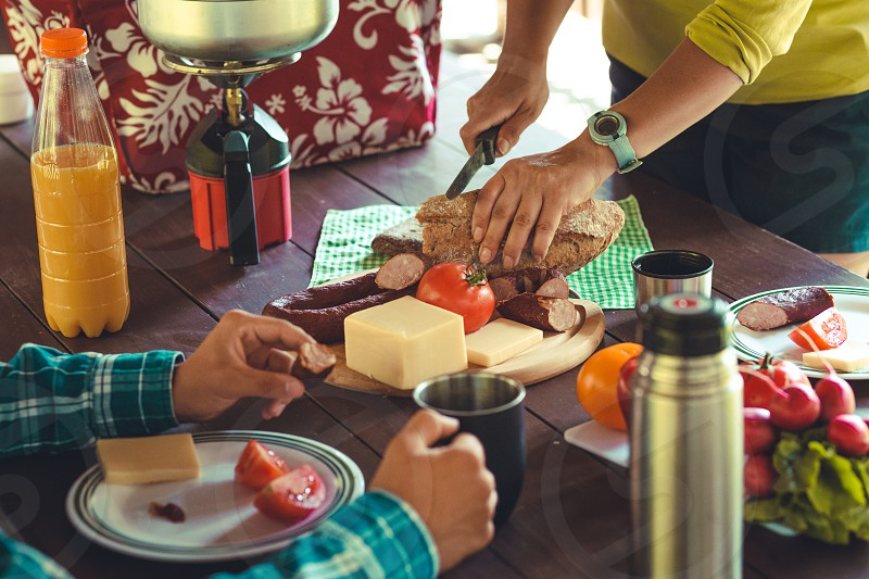 Preparing and eating a breakfast outdoor during spending vacation on camping photo