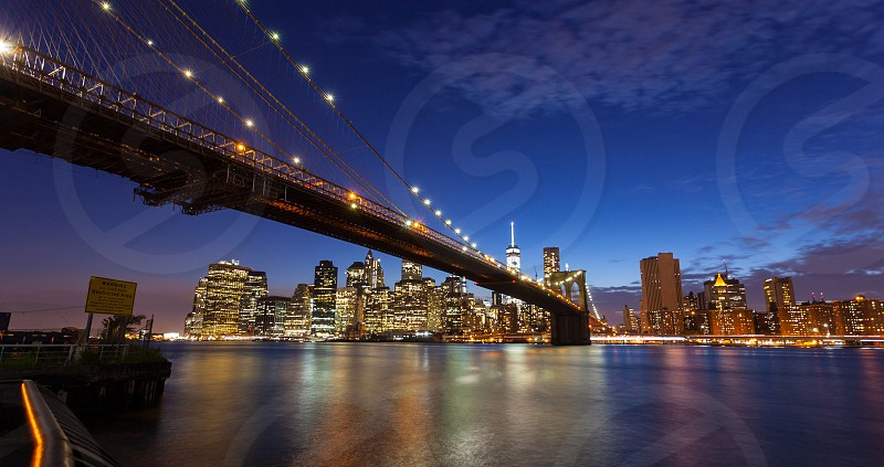 Spectacular view of Manhattan by night from Brooklyn Park New York City. photo